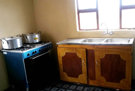 Kitchen with gas stove and running water