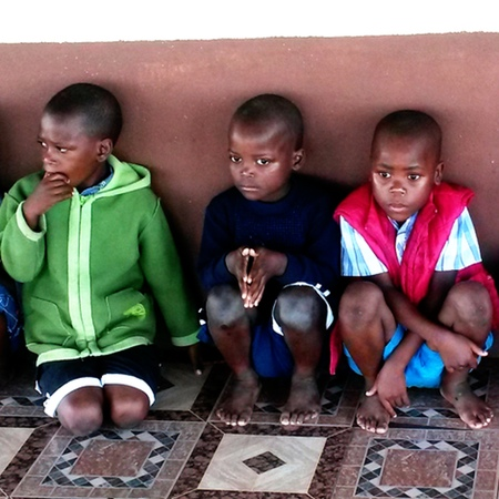 The children wear new warm clothing, they are still shy